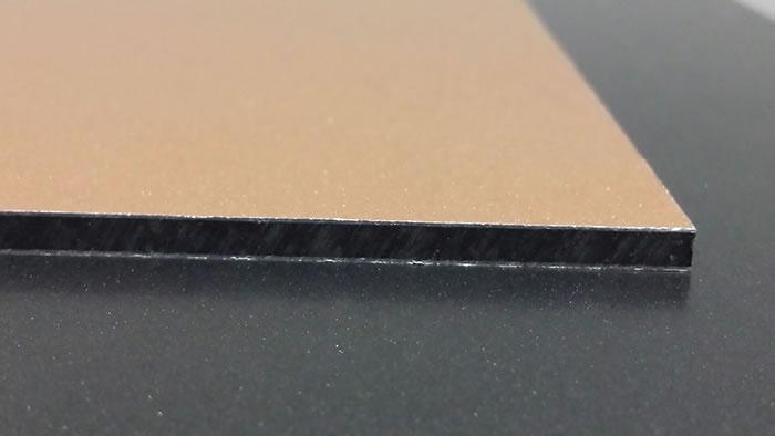 Custom garage door panel material composite