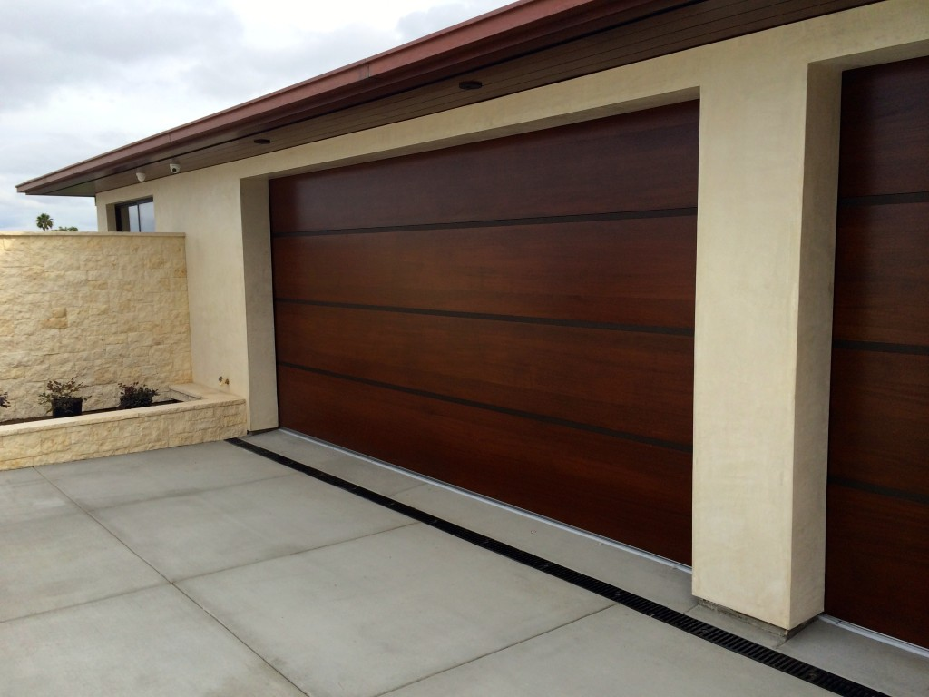 Custom garage doors melbourne timber wooden look doors for Cedar wood garage doors price