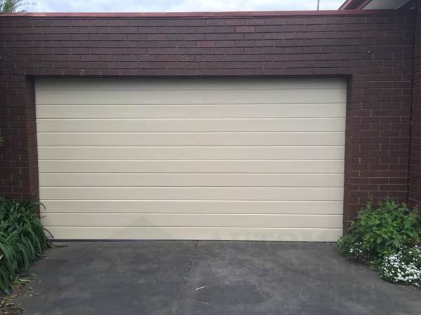 classic cream slimline design sectional garage door